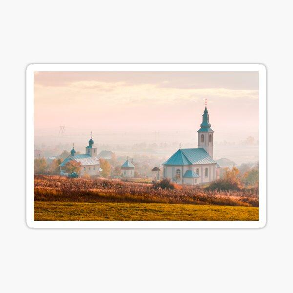 catholic and orthodox churches at foggy sunrise Sticker