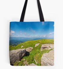 huge rocks on the grassy mountain side Tote Bag