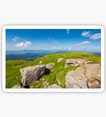 huge rocks on the grassy mountain side Sticker