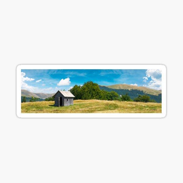 wooden hut on a grassy meadow Sticker