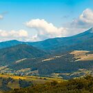 beautiful hilly countryside in autumn by mike-pellinni