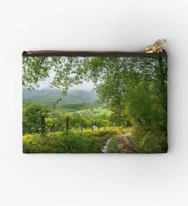 dirt road down the hill in to the rural valley Studio Pouch