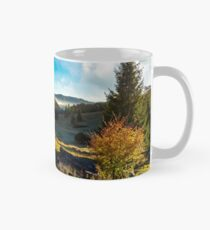 wonderful autumn sunrise with fog in the valley Mug