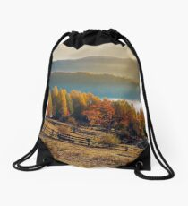 rural field and orchard in autumn at sunrise Drawstring Bag