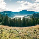 panorama of mountain and foggy valley by mike-pellinni