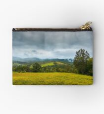 grassy rural meadow in mountains Studio Pouch