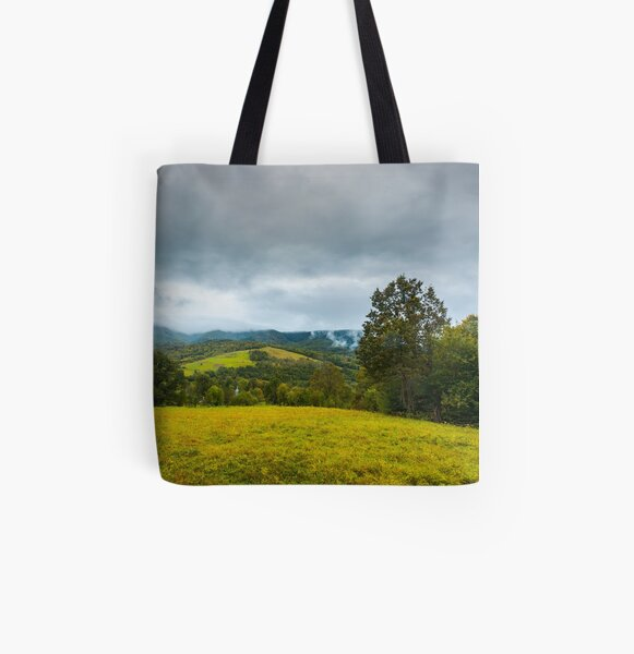 grassy rural meadow in mountains All Over Print Tote Bag