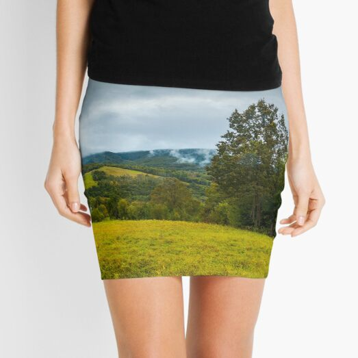 grassy rural meadow in mountains Mini Skirt