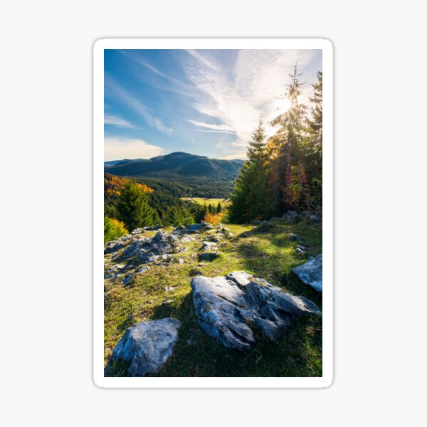 rocky cliff above the forested valley Sticker