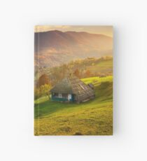 gorgeous mountainous countryside at sunrise Hardcover Journal