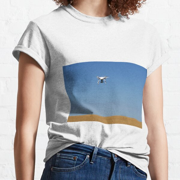 drone flying over golden wheat field  Classic T-Shirt