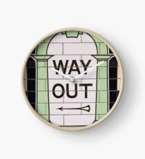 Way out sign in London underground station. UK. Clock