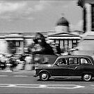 London Cab in Trafalgar Square, London, UK by aldogallery