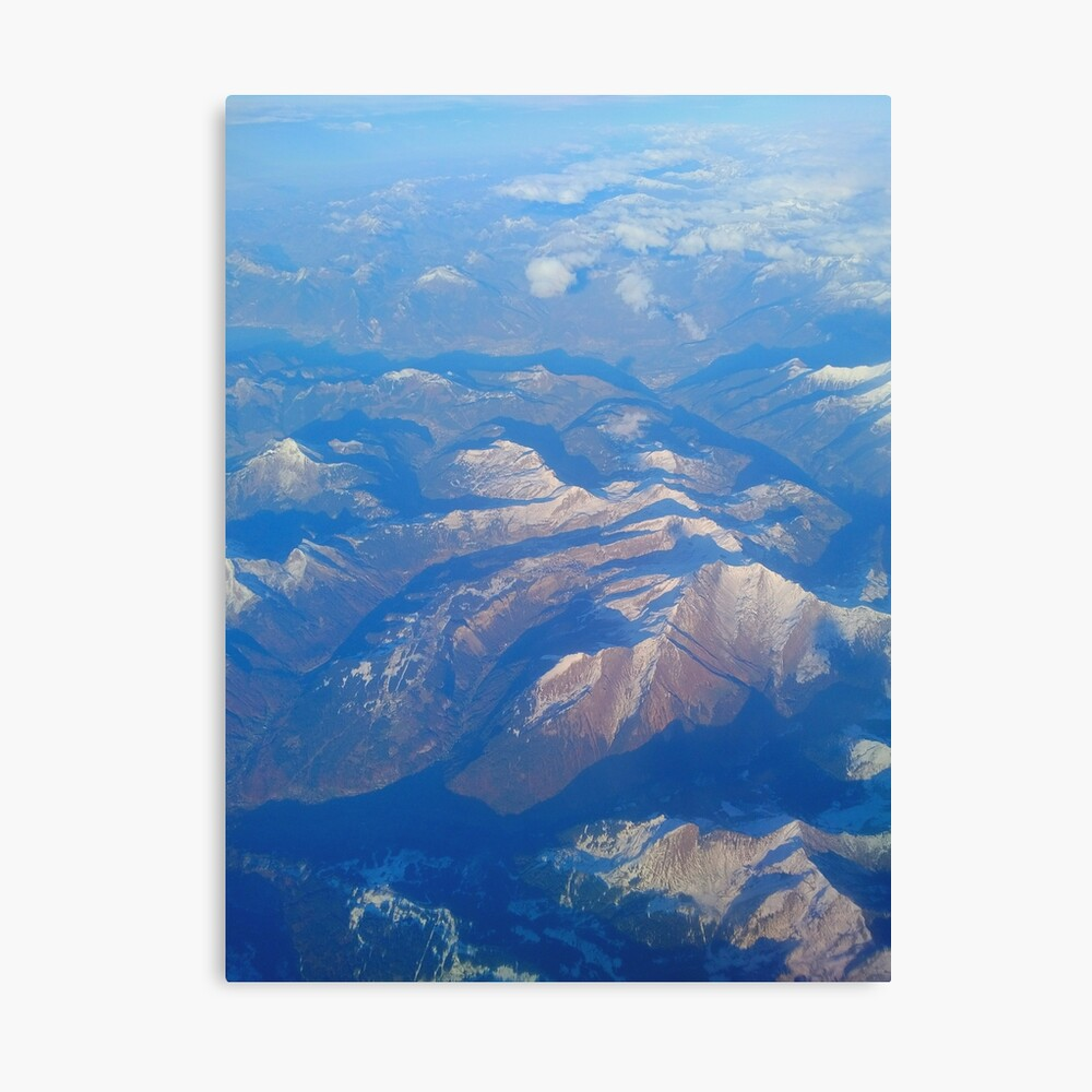 Mountains from the window seat Canvas Print