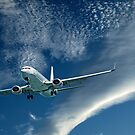 Aircraft in flight with Cirrocumulus cloud in blue sky. Australia. by sunnypicsoz