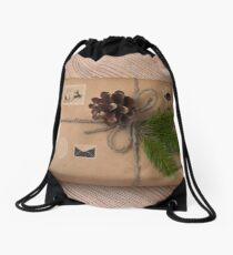 Christmas or New Year gift boxes wrapped in kraft paper with fir branch on wooden background. Drawstring Bag