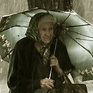 Old lady under rain by cheburashka