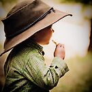 ...her daddy's hat... by Geoffrey Dunn