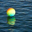 Rainbow Beachball Bobbing On The Ocean by Susie Peek