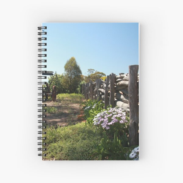 Flowers by the fence Spiral Notebook