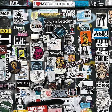 Amsterdam wall full of stickers by hypnotzd