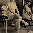 Vintage lady putting on socks photo by ClassicNudes