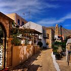 Between the Houses in Halki by Tom Gomez