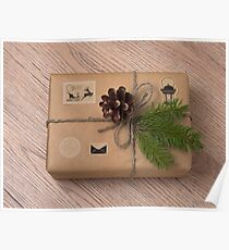 Christmas gift box wrapped in kraft paper. Poster