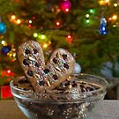 Gingerbread heart on decorated spruce background. by fotorobs
