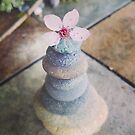 Pebble stack with blossom by Jennifer Lombard