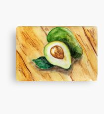 Watercolor illustration. Half of fresh raw avocado and whole avocado lying on a wooden surface. Canvas Print