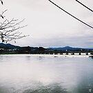 Togetsu Bridge in Arashiyama - Kyoto, Japan by IkuTree