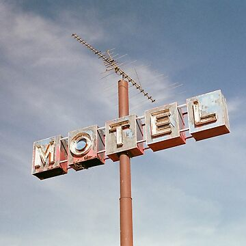 Motel sign with blue sky by franceslewis