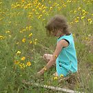 Child in field of daisies by andytechie