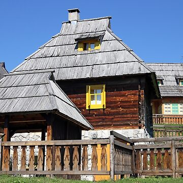 wooden cottages in old mountain village by goceris