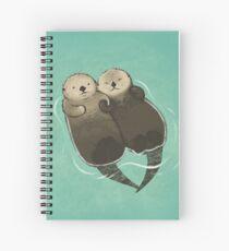 Bedeutende Otter - Otter, die Hände halten Spiralblock