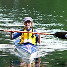 kid in a kayak by andytechie