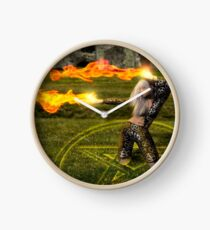 Witch casts fire from her hands Clock