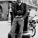 Man with vintage camera by Gabor Pozsgai
