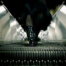 Coming down the escalator # 2 by Mikael Raymond
