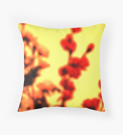 Red flowers in a blurry yellow world Throw Pillow