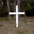 White cross in old graveyard by VisualFX
