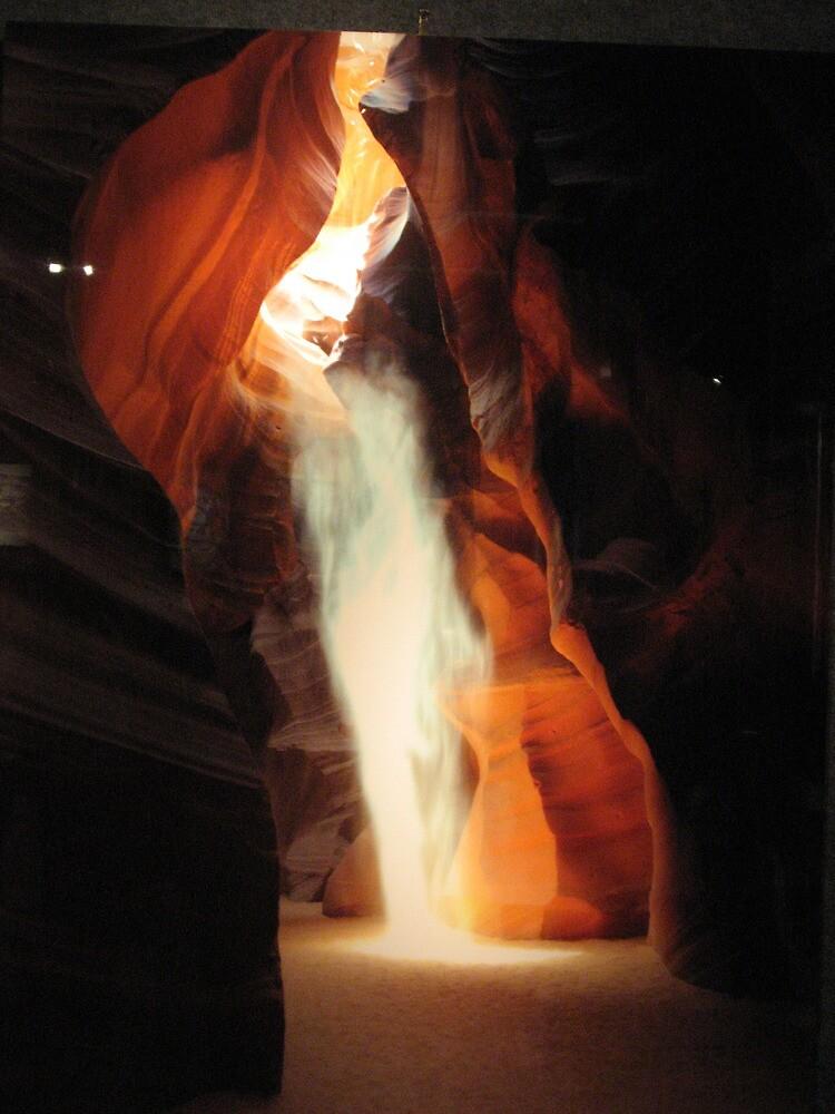 peaking sun penetrates inside a rock (orange glow) by sueg