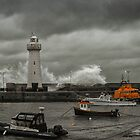Donaghadee Lighthouse - Rushing Waves by TomSmithPhotos