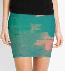 Water in different colors of blue, pink and orange Mini Skirt