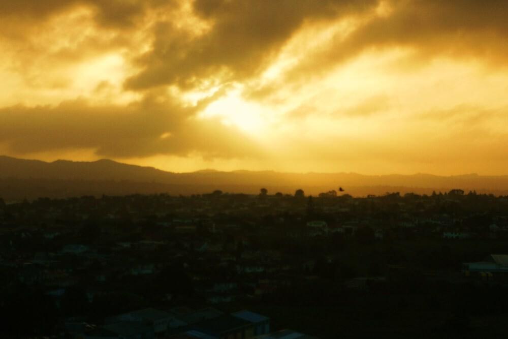 Sunset Through the Clouds by Adam Jones