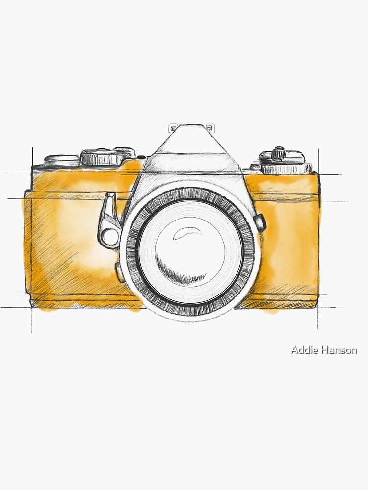 Hand erläuterte Kamera mit gelbem Spritzenhintergrund von addiemariehh