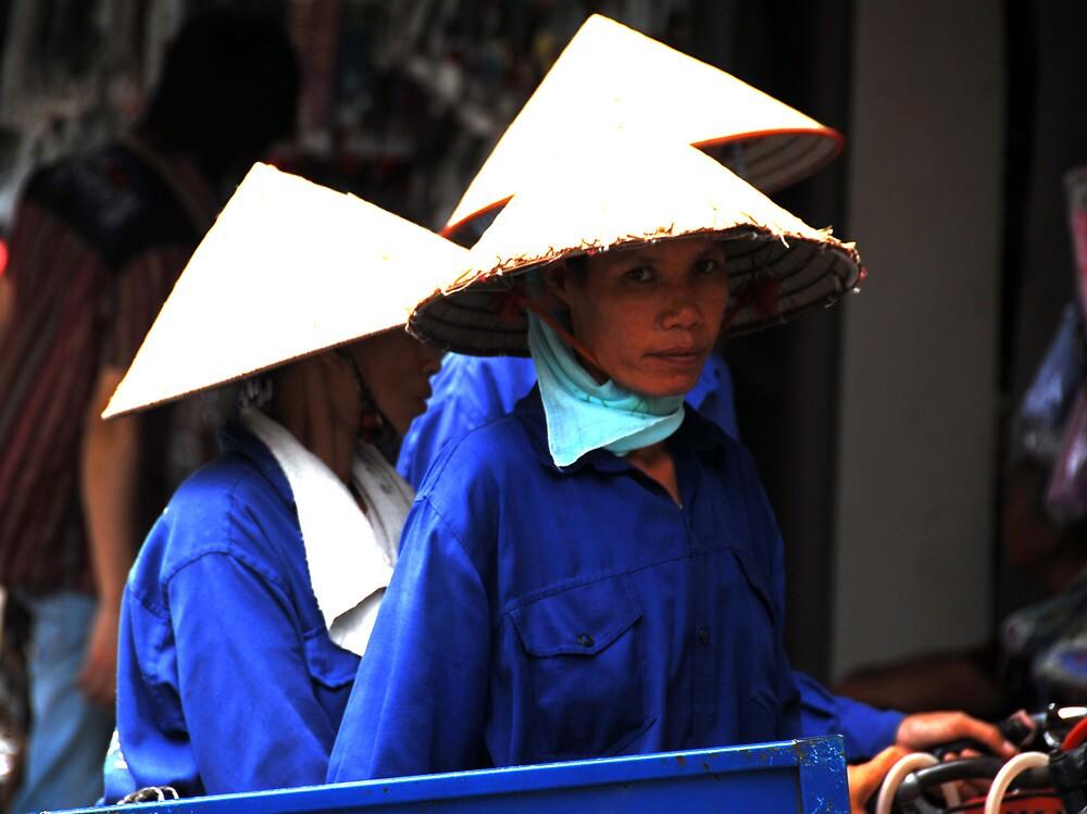 Vietnam Hanoi Women on Their Way to Work by noelmiller