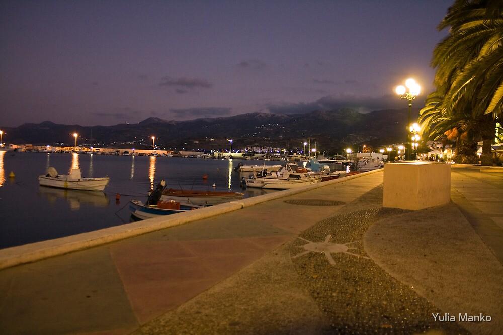 The quay in the evening in Sitia, Crete, Greece by Yulia Manko