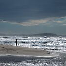Figure silhouetted on a beach in Sardinia, Italy by Michael Brewer